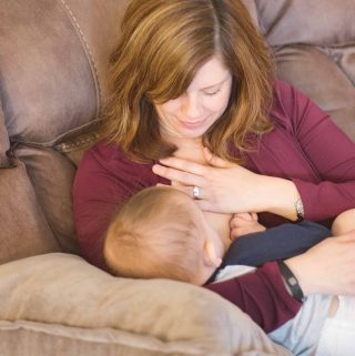 tandem breastfeeding a newborn and a toddler